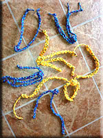 Toys made of rope knotted in the middle with two to four braided handles of varying lengths and thicknesses.